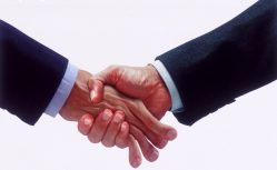 15 Apr 2000 --- An intimidating handshake --- Image by © John Lund/CORBIS